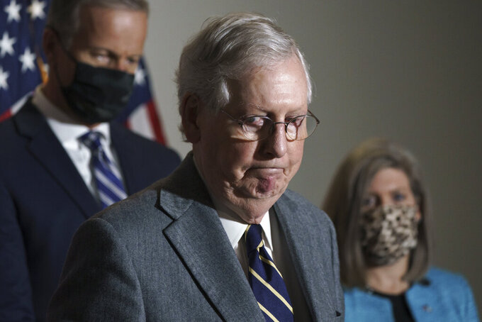 Senate Majority Leader Mitch McConnell, R-Ky., arrives to talk to reporters after a Republican Conference luncheon, on Capitol Hill in Washington, Tuesday, Nov. 17, 2020. (AP Photo/J. Scott Applewhite)