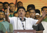 Presidential candidate of Sri Lanka's governing party Sajith Premadasa, center, speaks during his maiden election campaign rally in Colombo, Sri Lanka, Thursday, Oct. 10, 2019. Premadasa says he will put a former army chief in charge of national security if he wins, an apparent move to counter former defense chief and front-runner Gotabaya Rajapaksa, whose campaign centers on security following last Easter's deadly suicide bomb attacks.(AP Photo/Eranga Jayawardena)