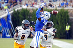 Duke's Jalon Calhoun (5) has the ball knocked away by the defense of North Carolina A&T's Joseph Stuckey (8) and Antoine Wilder (9) during the first half of an NCAA college football game in Durham, N.C., Saturday, Sept. 7, 2019. (AP Photo/Karl B DeBlaker)