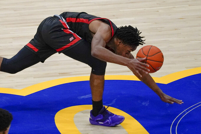 St. Francis' Ramiir Dixon-Conover controls the ball as he stumbles while driving to the basket against Pittsburgh during the first half of an NCAA college basketball game Wednesday, Nov. 25, 2020, in Pittsburgh. (AP Photo/Keith Srakocic)