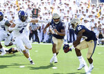 Navy quarterback Malcolm Perry pitches to slotback CJ Williams in the first quarter of an NCAA college football game against Holy Cross, Saturday, Aug. 31, 2019, in Annapolis, Md. (Paul W. Gillespie/Capital Gazette via AP)