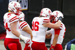 Nebraska quarterback Adrian Martinez, right, celebrates a touchdown against Ohio State with teammates during the first half of an NCAA college football game Saturday, Oct. 24, 2020, in Columbus, Ohio. (AP Photo/Jay LaPrete)
