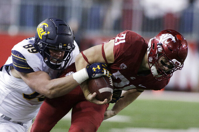 California linebacker Evan Weaver (89) tackles Washington State running back Max Borghi (21) during the second half of an NCAA college football game in Pullman, Wash., Saturday, Nov. 3, 2018. Washington State won 19-13. (AP Photo/Young Kwak)