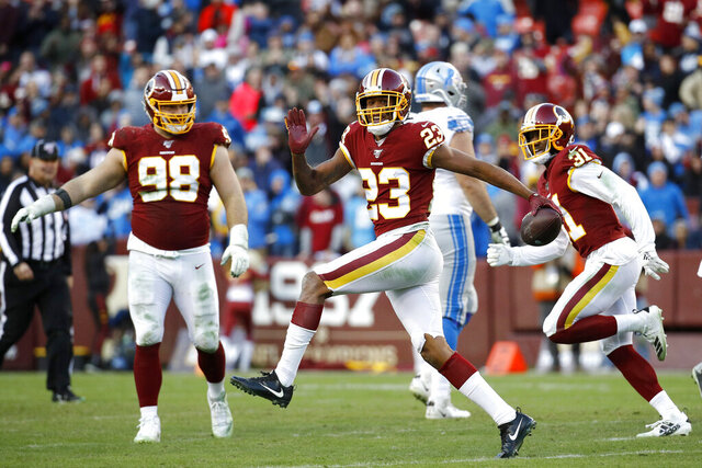 FILE - In this Nov. 24, 2019, file photo, Washington Redskins cornerback Quinton Dunbar (23) reacts after intercepting a pass from Detroit Lions quarterback Jeff Driskel during the second half of an NFL football game in Landover, Md. Dunbar got his wish when he asked out of Washington and got traded to Seattle during the offseason. Now he has a chance to learn the Seahawks system and potentially land himself a big pay day next year. (AP Photo/Patrick Semansky, File)