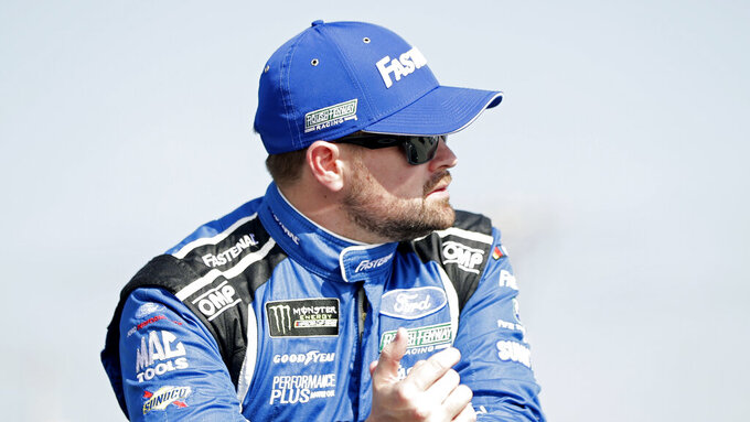 Ricky Stenhouse Jr. during introductions for the NASCAR Daytona 500 auto race at Daytona International Speedway, Sunday, Feb. 17, 2019, in Daytona Beach, Fla. (AP Photo/John Raoux)
