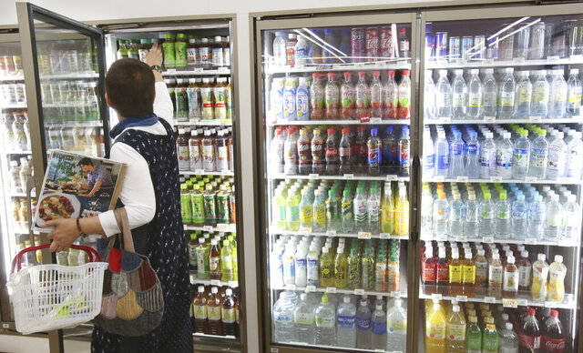 Plastic-bottled soft drinks are displayed in fridges at a store in Yokohama, near Tokyo, June 17, 2019. A U.N.-backed report claims making air conditioners and fridges more energy efficient and using more climate-friendly refrigerants can significantly slow global warming. (AP Photo/Koji Sasahara)