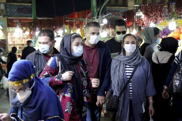 In this Oct. 15, 2020 file photo, people wear protective face masks to help prevent the spread of the coronavirus, in the Tajrish traditional bazaar in northern Tehran, Iran. On Monday, Oct.19, 2020, Iran recorded its worst day of new deaths since the start of the coronavirus pandemic, with 337 confirmed dead. (AP Photo/Ebrahim Noroozi, File)