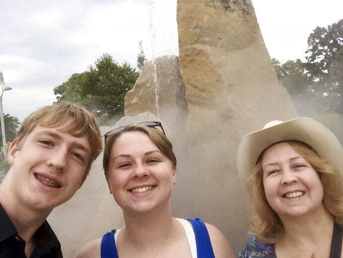 This October 2018 photo made available by Virginia Black, right, shows her niece, Alexandra Black, and her son, Anthony Hauguel, in Lafayette, Ind. Alexandra died in a fatal lion mauling at an animal sanctuary in North Carolina in Dec. 2018. Now, her aunt is urging lawmakers to strengthen regulations on animal facilities in the state. (Alexandra Black via AP)