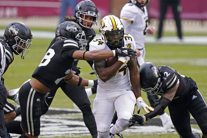 Missouri running back Larry Rountree III (34) is tackled after a short gain by a number of Mississippi State defenders during the first half of an NCAA college football game, Saturday, Dec. 19, 2019, in Starkville, Miss. (AP Photo/Rogelio V. Solis)