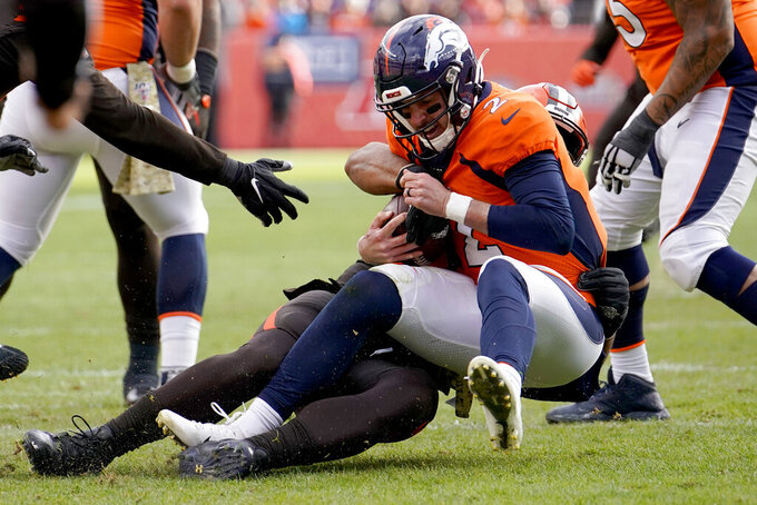 Denver Broncos quarterback Brandon Allen (2) is sacked by Cleveland Browns defensive end Olivier Vernon during the first half of NFL football game, Sunday, Nov. 3, 2019, in Denver. (AP Photo/Jack Dempsey)
