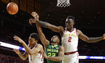 Baylor guard King McClure (22) has his shot blocked while driving to the basket between Iowa State's Nick Weiler-Babb, left, and Cameron Lard (2) during the first half of an NCAA college basketball game, Saturday, Jan. 13, 2018, in Ames, Iowa. (AP Photo/Charlie Neibergall)