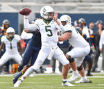Baylor quarterback Charlie Brewer (5) makes a pass against West Virginia during an NCAA college football game, Saturday, Oct. 3, 2020, in Morgantown, W.Va. (William Wotring/The Dominion-Post via AP)