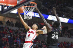 Mississippi guard Breein Tyree (4) takes a shot past Mississippi State forward Abdul Ado (24) during the second half of an NCAA college basketball game in Oxford, Miss., Tuesday, Feb. 11, 2020. Mississippi won 83-58. (AP Photo/Thomas Graning)