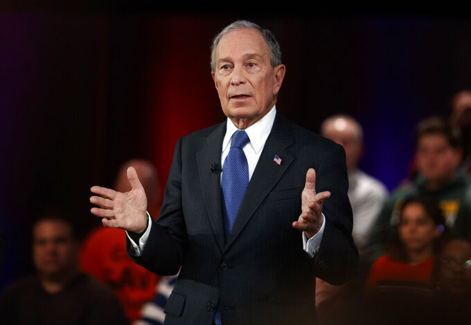 FILE - In this March 2, 2020, file photo, Democratic presidential candidate and former New York City Mayor Mike Bloomberg speaks during a FOX News Channel Town Hall in Manassas, Va. Bloomberg is one of the 50 Americans who gave the most to charity in 2020, according to the Chronicle of Philanthropy's annual rankings. (AP Photo/Carolyn Kaster, File)