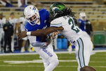 Tulsa quarterback Seth Boomer (12) is sacked by Tulane linebacker Dorian Williams (24) during the second half of an NCAA college football game in Tulsa, Okla., Thursday, Nov. 19, 2020. (AP Photo/Sue Ogrocki)