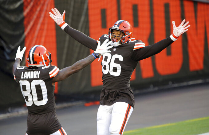 With no defense on the field for the drive, Cleveland Browns tight end Pharaoh Brown jokingly celebrates his touchdown catch with Jarvis Landry during the NFL football team's scrimmage Friday, Sept. 4, 2020, in Cleveland. (Joshua Gunter/Cleveland.com via AP)
