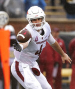 Arkansas quarterback Ty Storey fumbles a snap during the first half of an NCAA college football game against Missouri, Friday, Nov. 23, 2018, in Columbia, Mo. (AP Photo/L.G. Patterson)