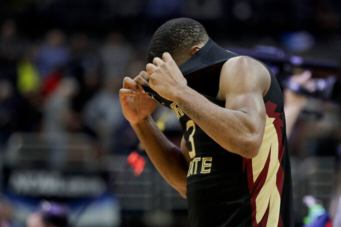 Florida State guard Trent Forrest pulls his jersey up after the team's loss to against Gonzaga during an NCAA men's college basketball tournament West Region semifinal Thursday, March 28, 2019, in Anaheim, Calif. (AP Photo/Jae C. Hong)