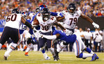 Chicago Bears running back Kerrith Whyte (38) breaks a tackle by the New York Giants during the third quarter of a preseason NFL football game, Friday, Aug. 16, 2019, in East Rutherford, N.J. (AP Photo/Adam Hunger)