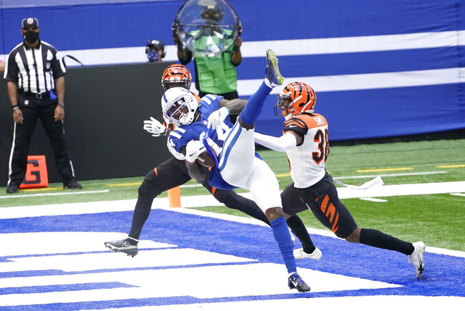 Indianapolis Colts' Zach Pascal (14) makes a touchdown reception against Cincinnati Bengals' LeShaun Sims (38) during the first half of an NFL football game, Sunday, Oct. 18, 2020, in Indianapolis. (AP Photo/AJ Mast)