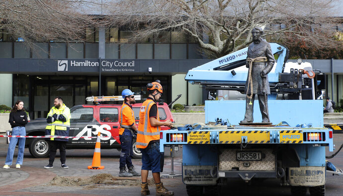 In this image provided by Hamilton City Council, council workers remove the bronze statue of British Captain John Fane Charles Hamilton from a square in central Hamilton, New Zealand, Friday, June 12, 2020. The New Zealand city of Hamilton on Friday removed a bronze statue of the British naval officer the city is named after a man who is accused of killing indigenous Maori people in the 1860s. (Hamilton City Council via AP)
