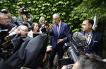 Gov. Jay Inslee, second right, is surrounded by reporters as he speaks about his plans to run for a third term as governor Thursday, Aug. 22, 2019, in Seattle. Inslee, who has ended his climate change-focused 2020 presidential bid, announced his plans earlier Thursday via email, hours before appearing at a news conference at Planned Parenthood in Seattle regarding the Title X family planning program. (AP Photo/Elaine Thompson)