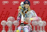 FILE - In this Saturday, March 13, 2010 file photo Lindsey Vonn, of the United States, poses with all the Olympic medals and Women's World Cup skiing trophies she won in her career, in Garmisch-Partenkirchen, Germany. (AP Photo/Giovanni Auletta, File)