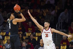 Colorado guard Tyler Bey, left, shoots over Southern California forward Nick Rakocevic during the first half of an NCAA college basketball game Saturday, Feb. 1, 2020 in Los Angeles. (AP Photo/Kyusung Gong)