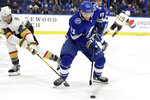 Tampa Bay Lightning center Brayden Point (21) loses the puck to a stick-check by Vegas Golden Knights defenseman Brayden McNabb (3) during the second period of an NHL hockey game Tuesday, Feb. 4, 2020, in Tampa, Fla. (AP Photo/Chris O'Meara)