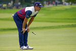 Gary Woodland, of the United States, lines up a putt on the first green during the first round of the US Open Golf Championship, Thursday, Sept. 17, 2020, in Mamaroneck, N.Y. (AP Photo/John Minchillo)