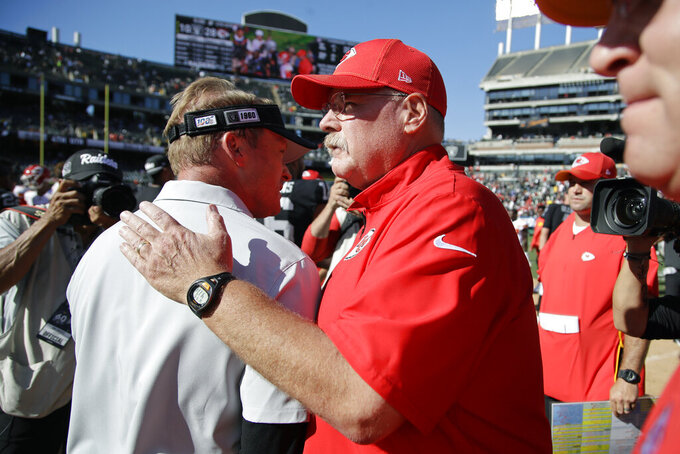 Oakland Raiders head coach Jon Gruden, left, is greeted by Kansas City Chiefs head coach Andy Reid at the end of an NFL football game Sunday, Sept. 15, 2019, in Oakland, Calif. Kansas City won the game 28-10. (AP Photo/Ben Margot)
