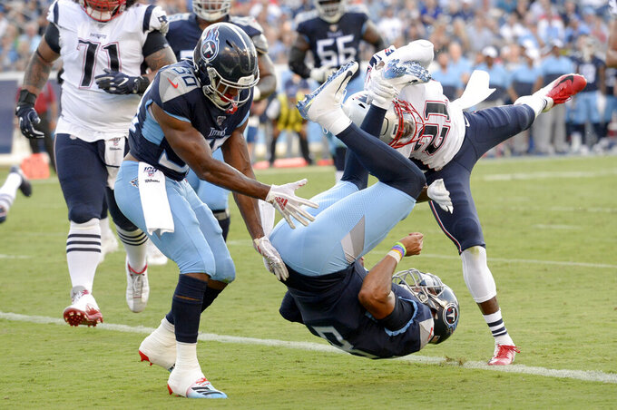 FILE - In this Aug. 17, 2019, file photo, Tennessee Titans quarterback Marcus Mariota (8) flips into the end zone as he converts a 2-point conversion against the New England Patriots in the first half of a preseason NFL football game, in Nashville, Tenn. Tennessee plays at the Cleveland Browns on Sunday. (AP Photo/Mark Zaleski, File)