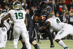 Cincinnati running back Michael Warren II (3) runs the ball against South Florida linebacker Greg Reaves (4) during the first half of an NCAA college football game, Saturday, Nov. 10, 2018, in Cincinnati. (AP Photo/John Minchillo)