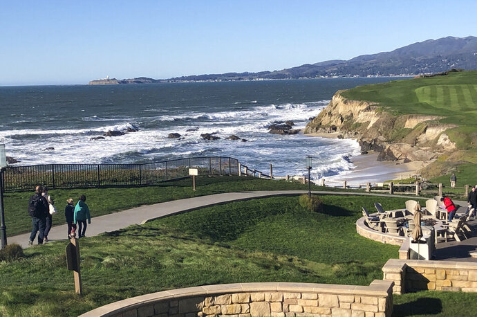 This Dec. 27, 2018 photo shows the beach below the Ritz-Carlton Hotel in Half Moon Bay, Calif. The California Coastal Commission was considering a $1.6 million fine against the hotel Thursday, June 13, 2019, for violating California laws requiring public coastal access. (AP Photo/Juliet Williams)