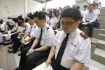 Salvation Army members pray for peace on the Korean peninsula during a service commemorating the 69th anniversary of the Korean War on June 25 at the Imjingak Pavilion, near the demilitarized zone of Panmunjom, in Paju, South Korea, Thursday, June 20, 2019. Chinese President Xi Jinping arrived Thursday morning for a two-day state visit to North Korea, where he's expected to talk with leader Kim Jong Un about the stalled negotiations with Washington over North Korea's nuclear weapons. (AP Photo/Ahn Young-joon)