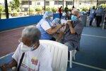 A nurse inoculates an elderly man with a dose of the Sputnik V COVID-19 vaccine at the 23 de Enero neighborhood in Caracas, Venezuela, Wednesday, June 9, 2021. ( AP Photo/Ariana Cubillos)