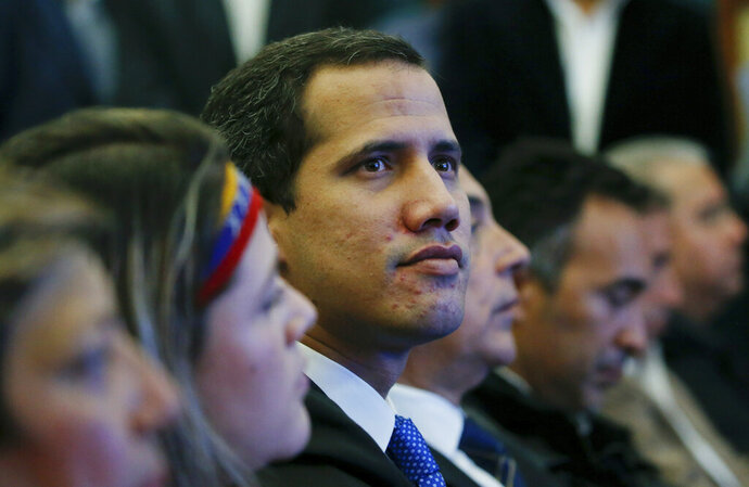 Venezuela's opposition leader and self-proclaimed interim president Juan Guaidó attends a meeting with the Chamber of Commerce, in Caracas, Venezuela, Thursday, May 16, 2019. Guaidó referred to the Norwegian initiative, efforts to mediate between the opposition and the government of President Nicolás Maduro, in remarks on Thursday, but said the opposition won't enter into any