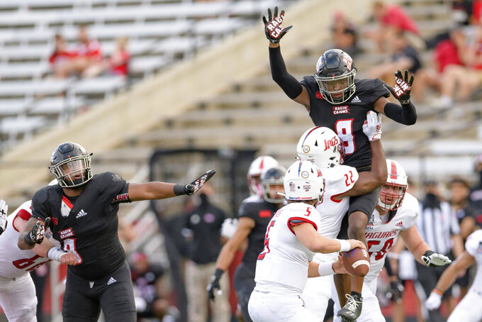 Louisiana-Lafayette safety Percy Butler (9) leaps to pressure South Alabama quarterback Chance Lovertich (5) in the second half of an NCAA college football game in Lafayette, La., Saturday, Nov. 14, 2020. (AP Photo/Matthew Hinton)