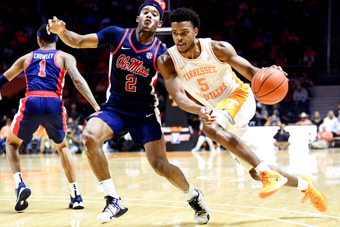 Tennessee guard Josiah-Jordan James (5) dribbles past Mississippi guard Devontae Shuler (2) during an NCAA college basketball game at Thompson-Boling Arena in Knoxville, Tenn. on Tuesday, Jan. 21, 2020. (Calvin Mattheis/Knoxville News Sentinel via AP)