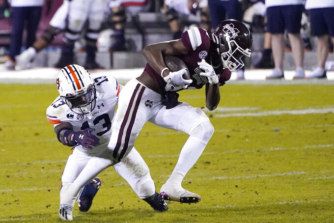 Mississippi State wide receiver Jaden Walley (31) pulls away from Auburn defensive back Ladarius Tennison (13) with a pass reception during the first half of an NCAA college football game Saturday, Dec. 12, 2020, in Starkville, Miss. (AP Photo/Rogelio V. Solis)