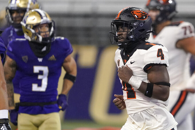 Oregon State running back B.J. Baylor (4) jogs to the bench after scoring a touchdown against Washington during the first half of an NCAA college football game Saturday, Nov. 14, 2020, in Seattle. (AP Photo/Ted S. Warren)