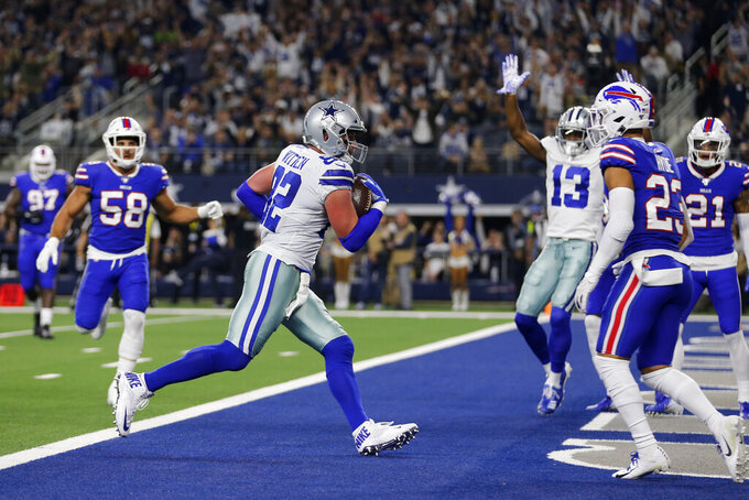Dallas Cowboys tight end Jason Witten (82) scores a touchdown after catching a pass as Buffalo Bills linebacker Matt Milano (58) and safety Micah Hyde (23) look on during an NFL football game in Arlington, Texas, Thursday, Nov. 28, 2019. (AP Photo/Michael Ainsworth)