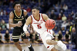 Arkansas guard Jalen Harris (5) drives against Vanderbilt's Saben Lee in the second half of an NCAA college basketball game in the Southeastern Conference Tournament Wednesday, March 11, 2020, in Nashville, Tenn. Arkansas won 86-73. (AP Photo/Mark Humphrey)