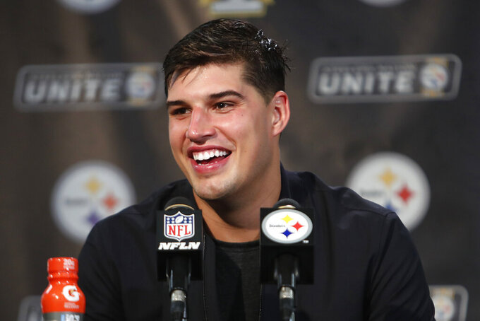 Pittsburgh Steelers quarterback Mason Rudolph talks with reporters following a 27-3 win over the Cincinnati Bengals in an NFL football game in Pittsburgh, Monday, Sept. 30, 2019. (AP Photo/Tom E. Puskar)