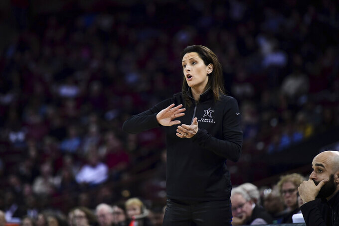 "File-This Feb. 17, 2020, file photo shows Vanderbilt coach Stephanie White communicating with players during the first half of an NCAA college basketball game Monday, Feb. 17, 2020, in Columbia, S.C.  Vanderbilt has fired White after five seasons and a 46-83 record.  Athletic director Candice Lee announced Tuesday, April 6, 2021, that White will not return. Lee thanked White and her staff for helping the players navigate the challenges during the coronavirus pandemic over the past year. ""As I continued my evaluation of the program, I ultimately concluded that change is needed at this time,"" Lee said in a statement. ""I wish Stephanie and her family the best."" (AP Photo/Sean Rayford, File)"