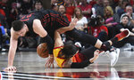 Portland Trail Blazers center Jusuf Nurkic, top, and Utah Jazz guard Ricky Rubio scramble for a ball during the second half of an NBA basketball game in Portland, Ore., Wednesday, April 11, 2018. The Blazers won 102-93. (AP Photo/Steve Dykes)
