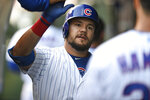 Chicago Cubs' Kyle Schwarber celebrates with teammates in the dugout after hitting a solo home run during the first inning of a baseball game against the Chicago White Sox Tuesday, June 18, 2019, at Wrigley Field in Chicago. (AP Photo/Paul Beaty)