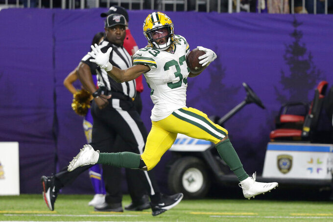 Green Bay Packers running back Aaron Jones runs for a 56-yard touchdown during the second half of the team's NFL football game against the Minnesota Vikings, Monday, Dec. 23, 2019, in Minneapolis. (AP Photo/Andy Clayton-King)