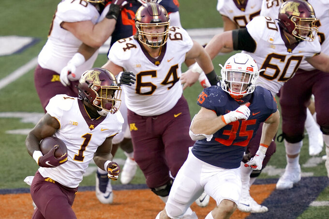 Minnesota running back Cam Wiley (1) carries the ball during the first half of an NCAA college football game against Illinois Saturday, Nov. 7, 2020, in Champaign , Ill. (AP Photo/Charles Rex Arbogast)