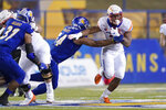 Boise State running back Andrew Van Buren (21) breaks a tackle by San Jose State defensive lineman Demanuel Talauati (54) during the first half of an NCAA college football game, in San Jose, Calif., Saturday, Nov. 2, 2019. (AP Photo/Tony Avelar)